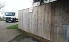 """Hasła """"Polacy do domu"""" na murach budynków w szkockim Dundee"""